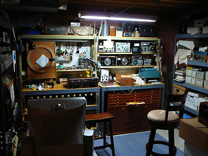 <b>The Service Bench Model Two</b> (2002) : Figure 77 : This is where it all happens. I service all my radios from this bench. That is an Atwater Kent Model 20C radio currently undergoing testing. All five tubes tested, are good. :