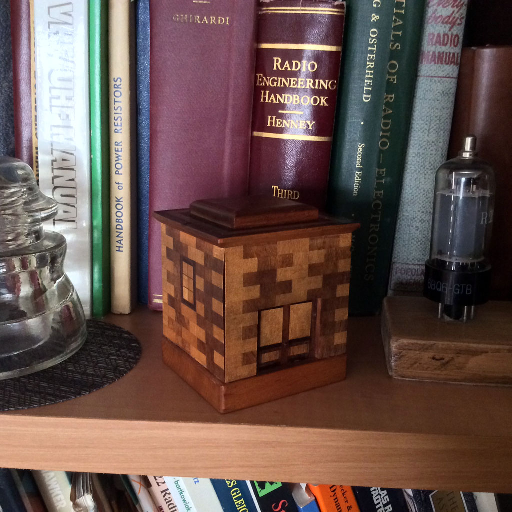 <b>Japanese Puzzle Bank </b> (1960) : Figure 98 : Japanese puzzle bank with very nice wood marquetry. Has a simple trick opening. Also shown are various books in my collection. :