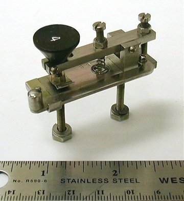 "<b>Bunnell Co., J. H. 6b Line Key 43</b> (1960) : Figure 51 : This Model 6B is one of the smallest actual operating straight keys. It was made by J. H. Bunnell Co. for Western Electric Company. It is about 2"" long and it was used in telegraphy test gear in multiples of four for meter bridge testing. :"